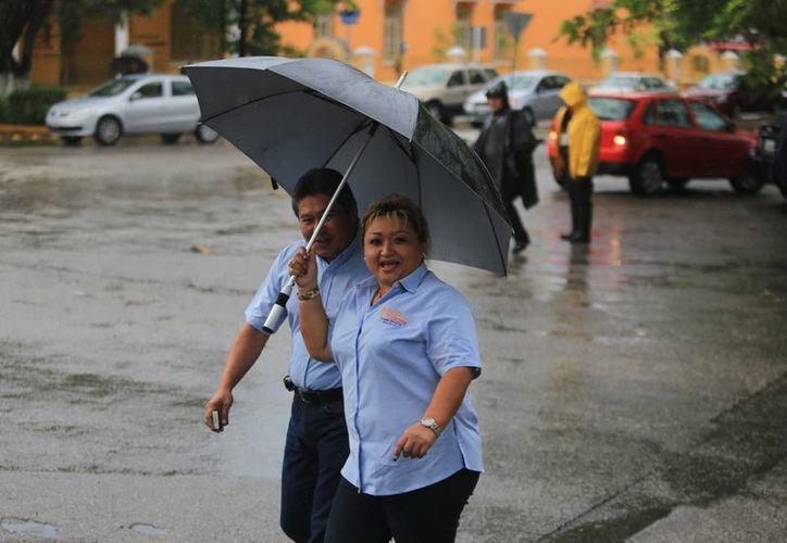 Las lluvias intermitentes afectaron las actividades de los meridanos. (Mauricio Palos/SIPSE)