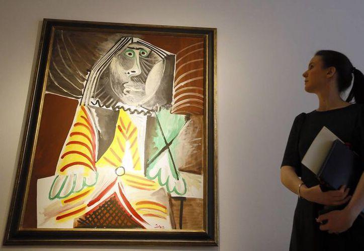 El compromiso que sentía Picasso con la pintura y el arte le hizo explorar sus límites y romper las reglas establecidas de los retratos, es por eso que 'Picasso Portraits' es una exposición fundamental del arte moderno. (Archivo/Robert Doisneau/ AP/ DACS)