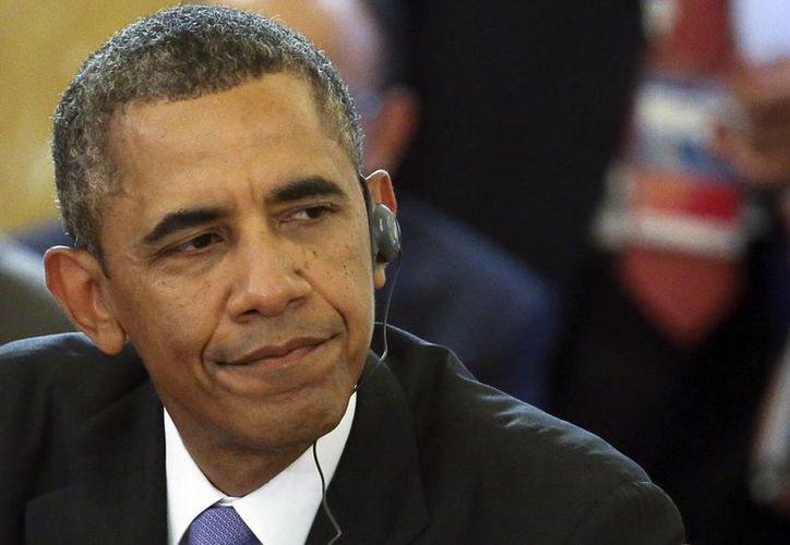 Obama perdió, en primera instancia, el apoyo de la Gran Bretaña para intervenir en Siria. (Agencias)