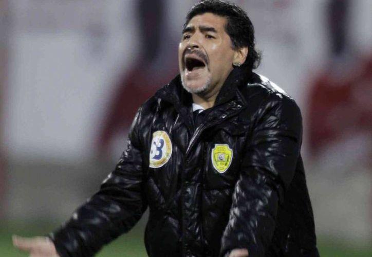 Maradona terminó en malos términos su labor como entrenador de la selección argentina con la AFA, encabezada por Grondona. (Agencias)