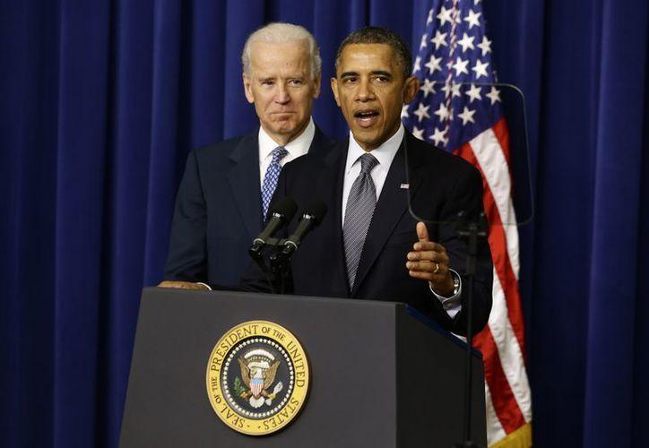 Joe Biden y Barack Obama durante la conferencia en la Casa Blanca. (Agencias)