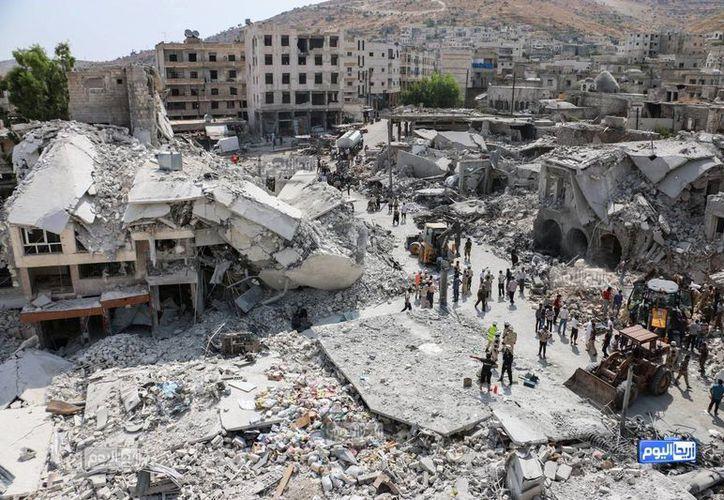 En imagen, la zona residencial de Ariha que fue destruida tras caer una aeronave, durante un enfrentamiento entre las fuerzas del gobierno e insurgentes. (AP)