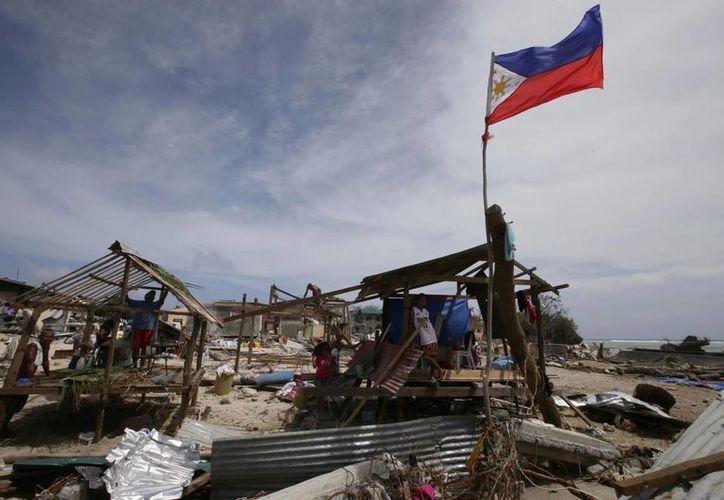 El Consejo de Desastres de Filipinas ya reportó 255 muertos. (Agencias)