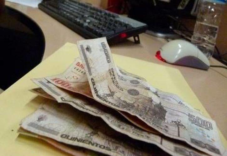 Las remesas familiares y el ingreso real de trabajadores del Imss mostraron una evolución desfavorable en el primer trimestre de 2013. (Milenio)