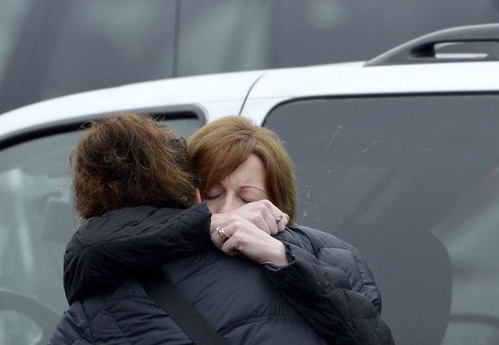 La sociedad americana continúa sin explicarse la causa del asesinato. (EFE)