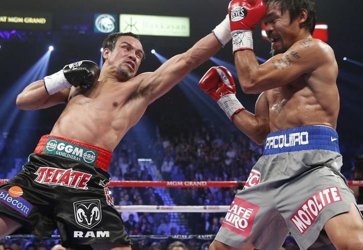 Márquez será quien decida si pelea o no una quinta vez contra Pacquiao. (Foto: Agencias)