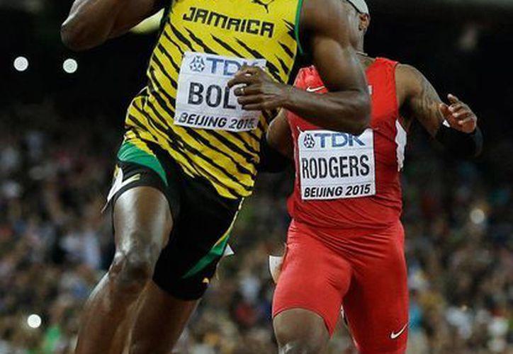 Usain Bolt volvió a dejar claro quién es el hombre más rápido del planeta: recorrió los 100 metros planos, en el Mundial de Atletismo, en 9.79 segundos. (AP)