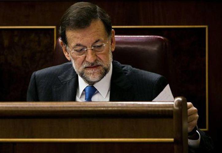 Mariano Rajoy, había dicho en septiembre de 2012 que no rebajaría las pensiones. (Archivo/AP)