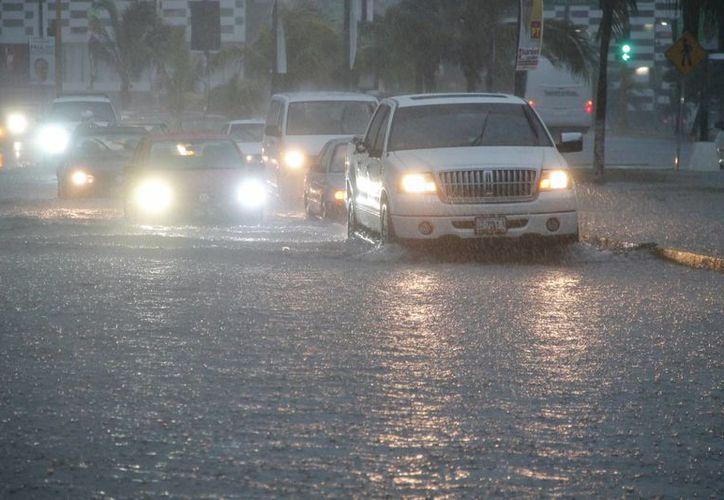 Mantendrá nubosidad densa con potencial de lluvias sobre la Península de Yucatan. (Israel Leal/SIPSE)