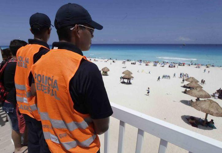 Elementos de seguridad de diferentes corporaciones cuidarán que las vacaciones de verano en Cancún sean seguras. (Cortesía)
