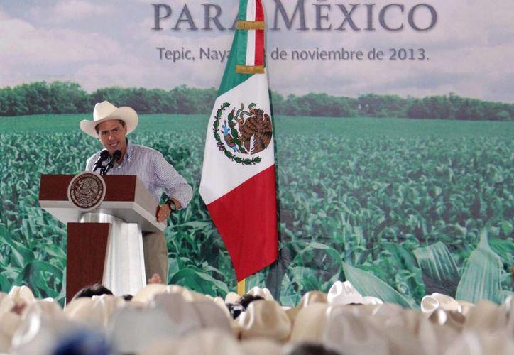 Peña Nieto dijo que su gobierno quiere cambiar el rostro del campo. (Notimex)