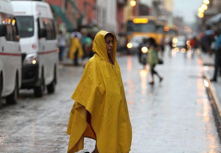 La Conagua reporta que en las próximas horas se registrarán lluvias muy intensas en estados de la Península de Yucatán. (Archivo/Notimex)