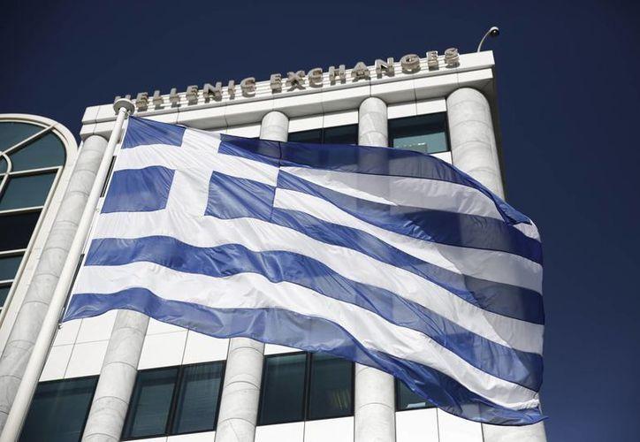 Funcionarios del partido gobernante de Grecia, Siriza, había convocado al impago de la deuda al FMI. (Archivo/AP)