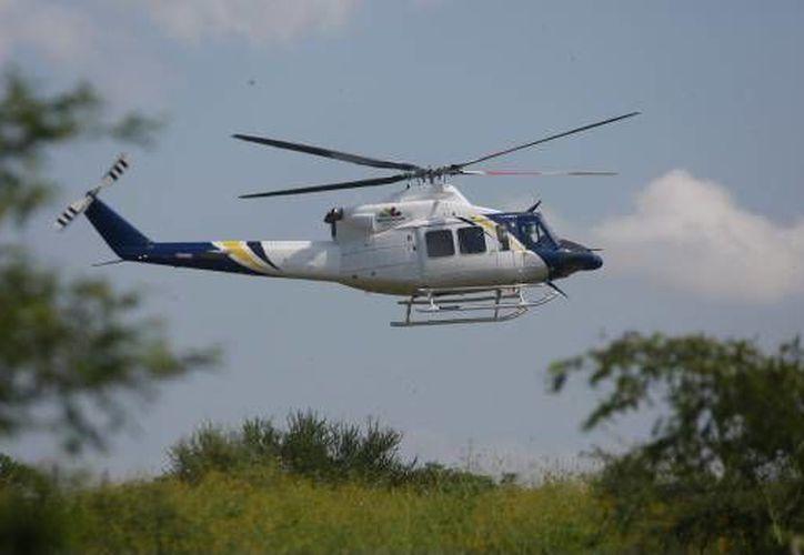 Un helicóptero fumigador de la Fuerza Aérea Mexicana se desplomó cerca de la zona serrana de Filo de caballo, (Foto: Archivo Cuartoscuro)