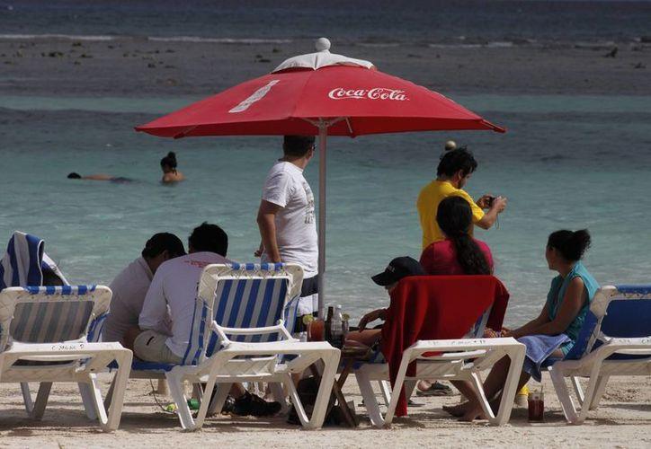 Todos los prestadores de servicios de Majahual se vieron beneficiados con el aumento de visitantes durante el último día de 2013. (Archivo/SIPSE)