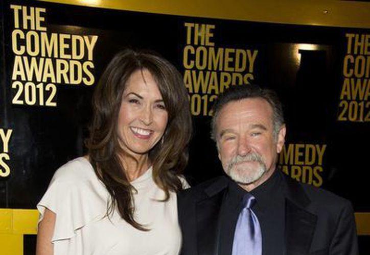 Sigue la disputa por la herencia del fallecido actor Robin Williams, quien en la foto aparece con su tercera esposa, Susan. (AP)