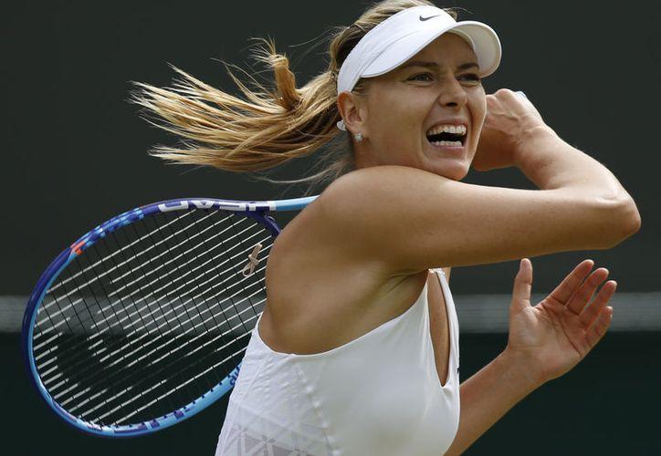 Sharapova está recuperándose de una lesión en su brazo izquierdo. (Foto: denverpost.com)