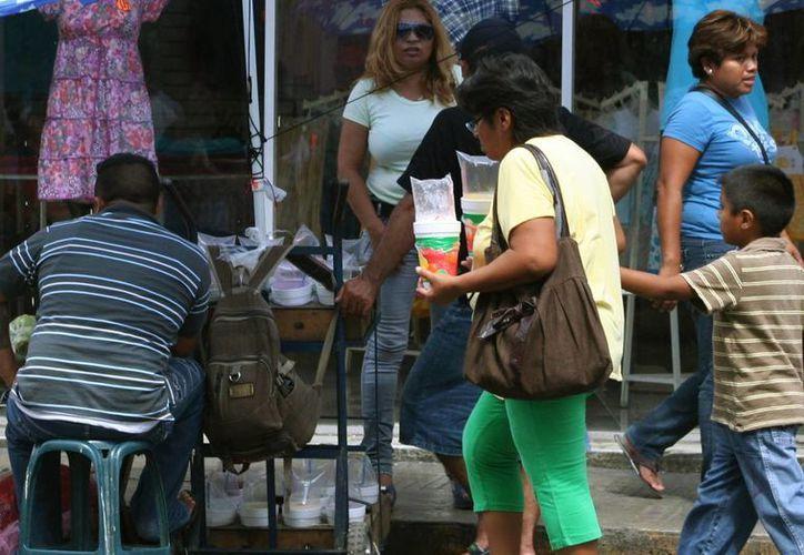 Empresarias de Mérida señalan que el daño que genera el ambulantaje es alto. (Milenio Novedades)