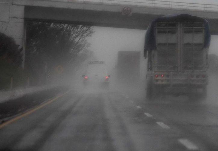 Ante las fuertes lluvias la capacidad de respuesta del gobierno estatal de Veracruz se ha reforzado con los apoyos proporcionados por el gobierno de la República. (Notimex/Foto de contexto)