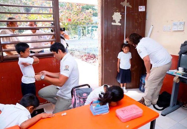 Supervisan trabajos de medición a 14 alumnos de primaria. (Milenio Novedades)