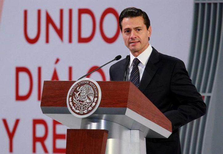 El presidente Enrique Peña Nieto se ha movilizado para reducir los impactos negativos de la victoria de Trump a la presidencia de EU. (Archivo/Notimex)