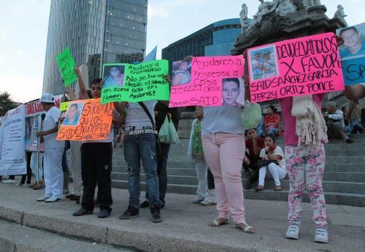 Manifestación de familiares de jóvenes raptados en el bar Heaven, en julio del año pasado. Entonces todavía no habían sido entregados los restos. Hoy lo que se busca es castigar a los responsables. (Agencias/Foto de archivo)