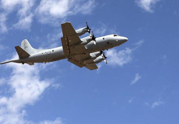 Aviones chinos y japoneses se unieron a la búsqueda del avión de Malaysia Airlines. (Agencias)