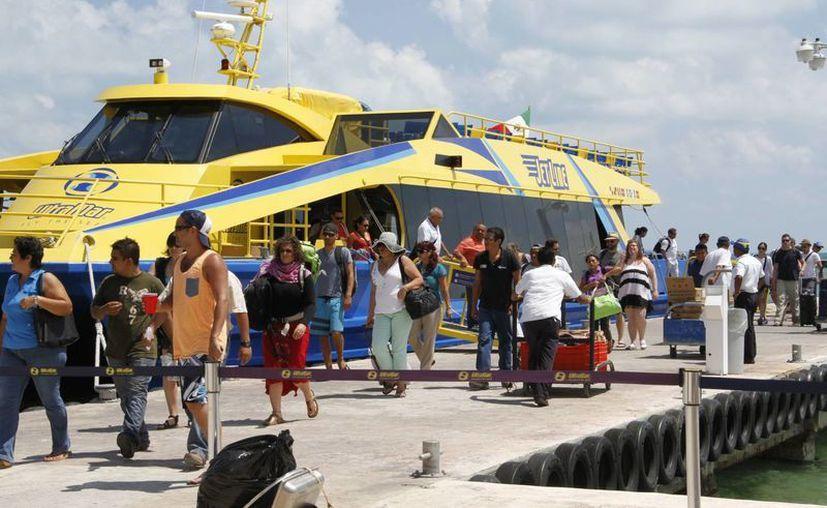 Reportan lleno total en los viajes hacia la isla. (Israel Leal/SIPSE)