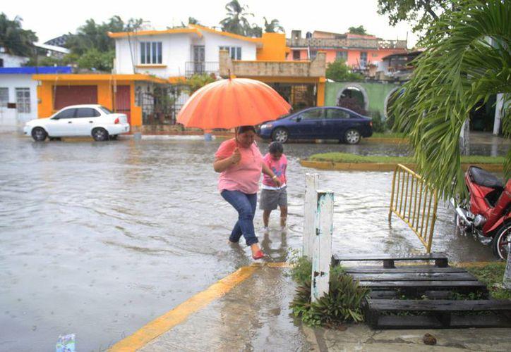 Detalló que durante los meses de julio, septiembre y noviembre se registró el mayor número de lluvias e inundaciones en el estado. (Harold Alcocer/SIPSE)