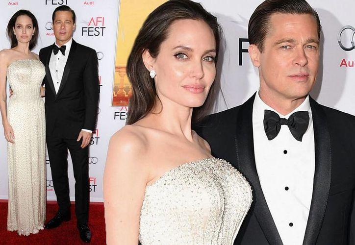 Brad Pitt y Angelina Jolie en sus buenos tiempos. La pareja ha llegado a un acuerdo sobre la custodia de sus hijos. (mirror.co.uk)