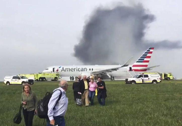 El avión accidentado cubría el vuelo 383 y estaba por despegar con destino a la ciudad de Miami.(Jose Castillo/AP)