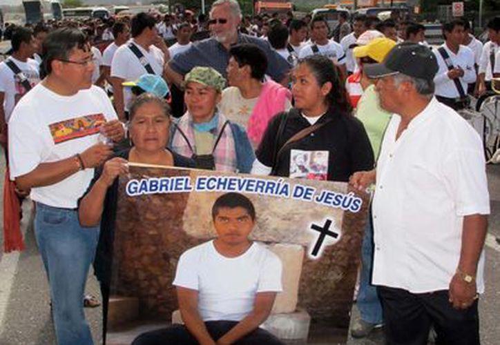 Familias exigen justicia por el asesinato de los jóvenes normalistas en diciembre de 2011. (Archivo/Notimex)
