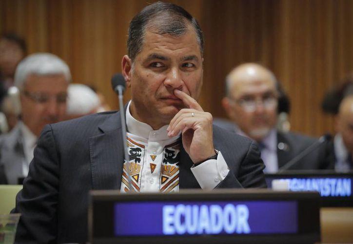 No es la primera vez que Rafael Correa denuncia a alguien por injurias, pero sí la primera vez que cobra la indemnización. (AP/Bebeto Matthews)