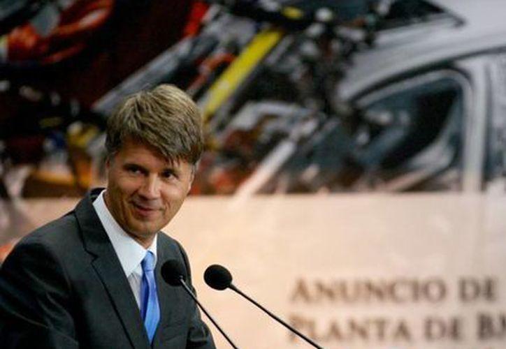 Harald Krüger, responsable de la producción de BMW anunció inversiones por mil millones de dólares en México. (presidencia.gob.mx)