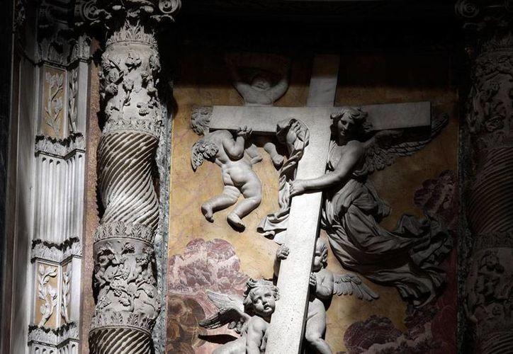 A pesar del avance de otras religiones como el islam, el cristianismo se mantendrá como la religión con más adeptos en el mundo. La imagen es solamente ilustrativa y corresponde a un aspecto del interior de la Basílica de San Pedro, en el Vaticano. (AP)