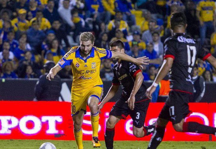 Los Tigres no pudieron anotar por segunda jornada consecutiva y se van en ceros ante el Atlas, que también lleva dos empates en el inicio del torneo. (Mexsport)