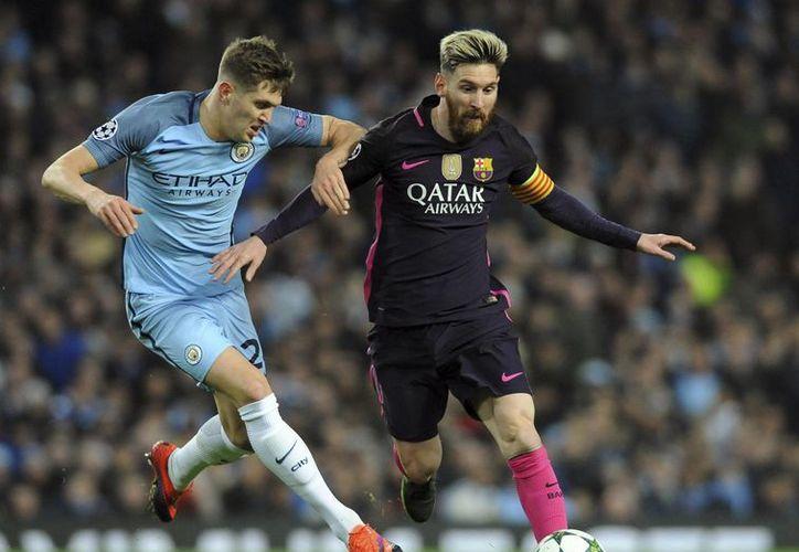 Lionel Messi y Cristiano son los futbolistas favoritos para ganar el premio que entregará la FIFA, en enero de 2017. (Rui Vieira/AP)