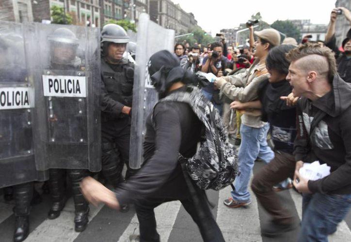 En el expendiente hay imágenes que comprueban su participación en las agresiones. (Archivo/Notimex)