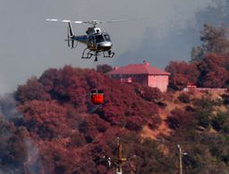 Firefighters battle wildfires up and down California