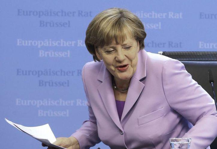Angela Merkel es considerada pieza clave para la economía de Europa y concretamente en las negociaciones que la Unión Europea llevaba a cabo con Grecia para mitigar su crisis económica. (EFE)
