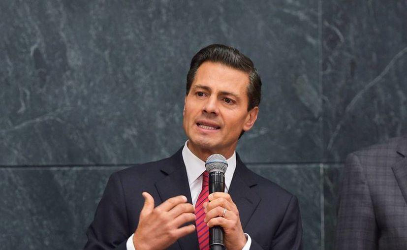 Peña Nieto sigue sin pronunciarse personalmente sobre las acusaciones de plagio en su tesis de licenciatura. (Archivo/Notimex)