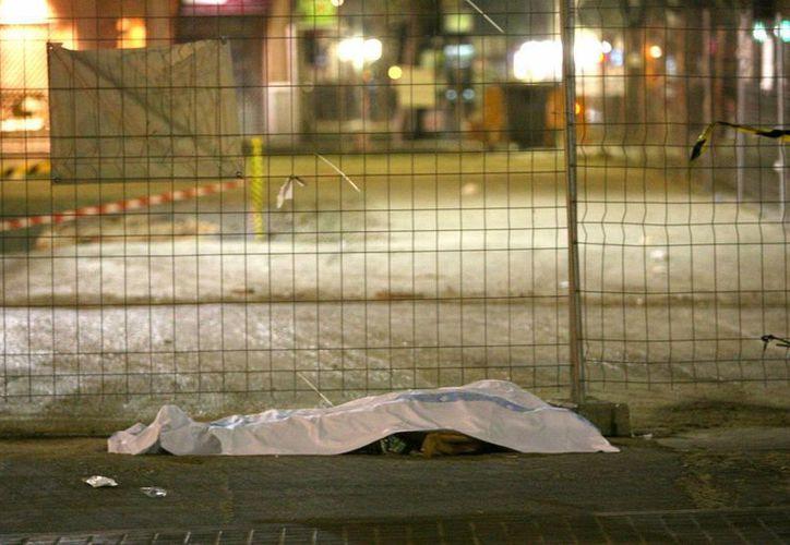 En 2012, la tasa de homicidios de Honduras se ubicó en 90.4 por cada 100 mil habitantes, según una oficina de la ONU. (EFE/Archivo)