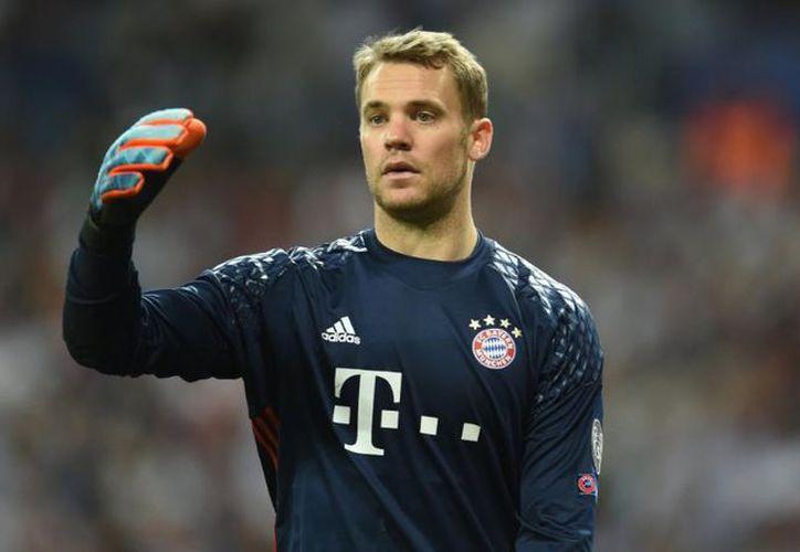 En su primer entrenamiento Neuer paró algunos tiros. (DPA)