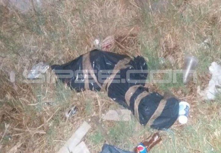El cuerpo fue hallado este jueves por la tarde en un basurero del puerto de Chelem. (SIPSE)