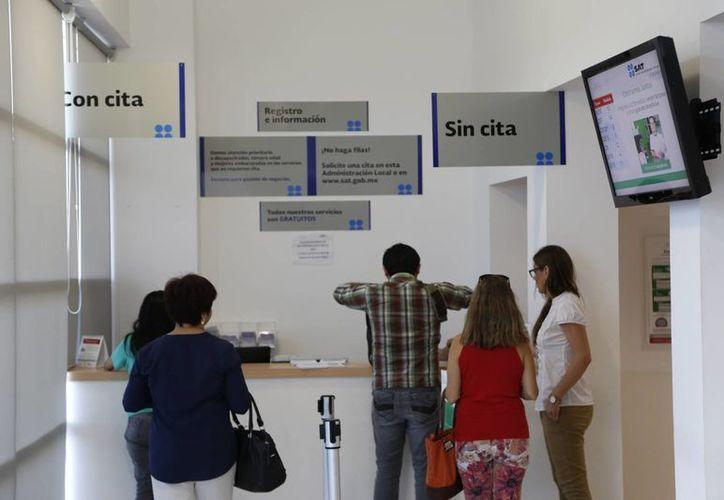 El portal del SAT no permite realizar algunos trámites. (Israel Leal/SIPSE)