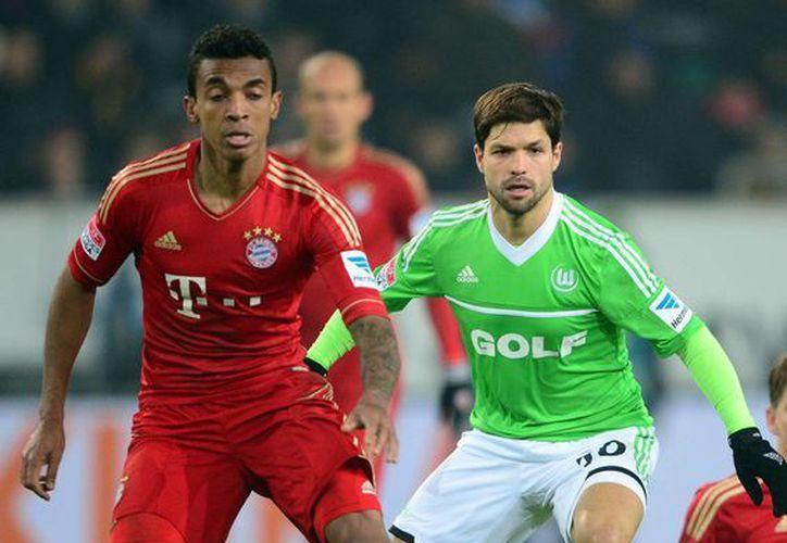 Luiz Gustavo (i) llegó al Bayern en enero de 2011, procedente del Hoffenheim, por 17 millones de euros. (Agencias)