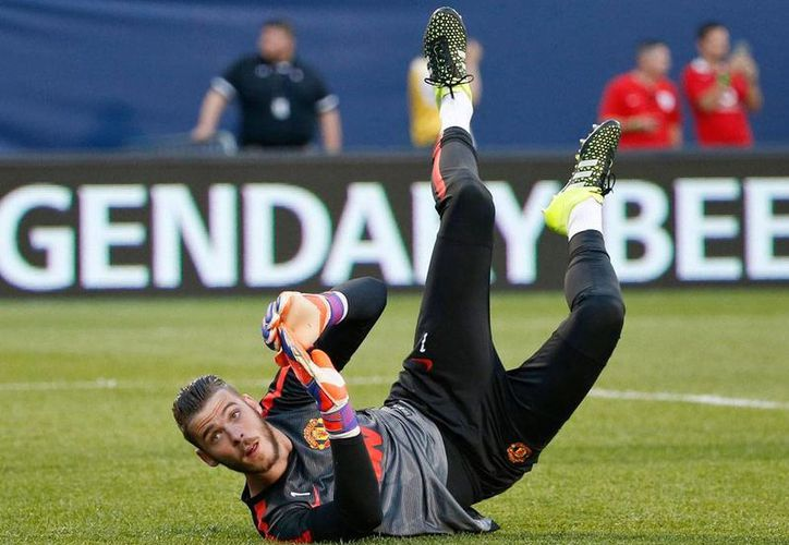 El portero David De Gea renovó contrato con el Manchester United por los próximos cuatro años. (AP)