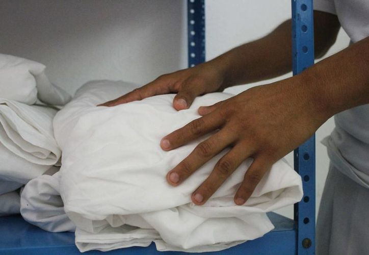 La mantelería es utilizada en eventos por los socios y operadores taxistas. (Yajahira Valtierra/SIPSE)