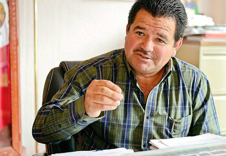 Foto de archivo del alcalde de, César Miguel Peñaloza, quien esta mañana fue puesto en libertad, tras ser acusado de delincuencia organizada, por la desaparición de 43 normalistas. (excelsior.com.mx)