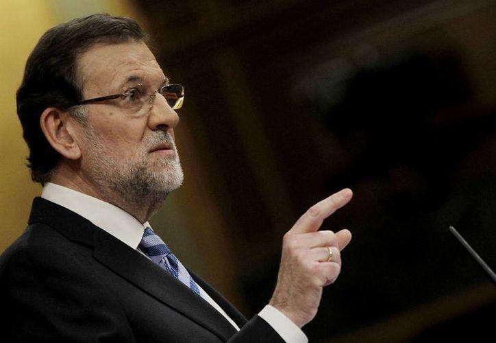 El ministro español José Manuel García-Margallo pidió a los grupos parlamentarios el apoyo para que el presidente en funciones, Mariano Rajoy (en la imagen), asuma en el Consejo Europeo. (Archivo/Notimex)
